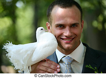 Groom with the pigeon