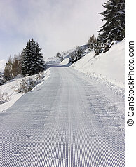 groomed road in mountain