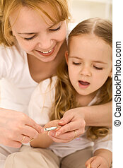 Grooming theme - woman cuts little girls nails - Personal...