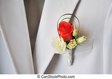 groom's red and white rose boutonniere in wedding day