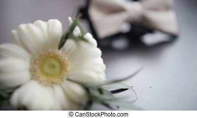 Groom's tie and wedding boutonniere on white background,...
