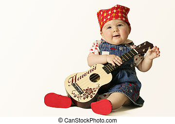Grooovy baby - babygirl in denim dress with small guitar (on...