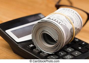 gros plan, ang, roulé, dollars, glasses., billets banque, américain, calculatrice