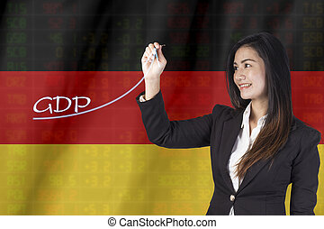Gross Domestic Product (GDP) improvement concept. Businesswoman draw accelerating line of growing gdp. on Germany Flag background