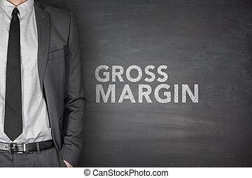Gross margin on black blackboard with businessman