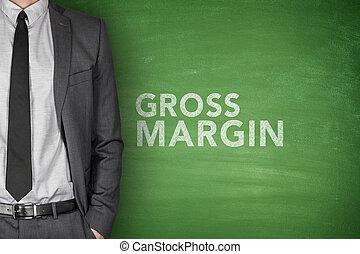 Gross margin text on green blackboard with businessman