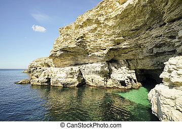 Grotto in the rock on the beach . Tarhankut. Crimea