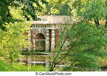 Grotto on the pond?s shore