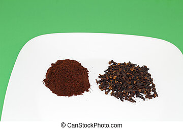 Ground and Whole Cloves - A half ounce pile of cloves next...
