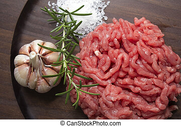 Ground beef with garlic and fresh rosemary.
