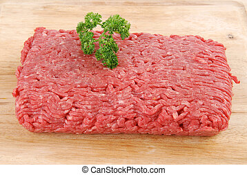Ground beef - Fresh uncooked ground beef on a cutting board