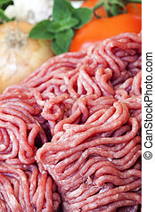 Ground Beef - Raw ground beef, with tomatoes, onion, garlic...