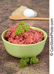 ground beef with parsley - closeup of ground beef with...
