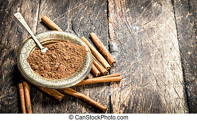 Ground cinnamon in a bowl.