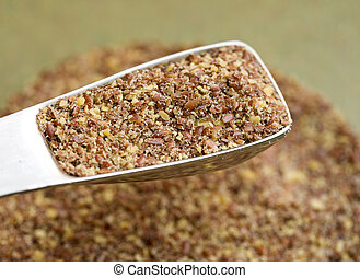 Ground flax seeds in tablespoon