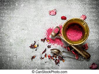 Ground pomegranate tea in a mortar.