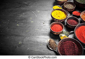 Ground spices in bowls and spoons.