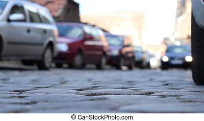 Ground View Cobblestone Street Car - Bottom view of cars...