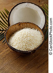 grounded coconut flakes and fresh coconut