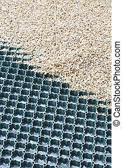 Groundguard grid for gravel