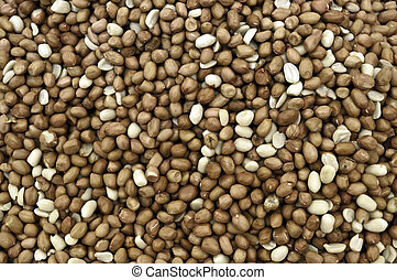 Groundnuts - Brown groundnuts with peel in a market stock