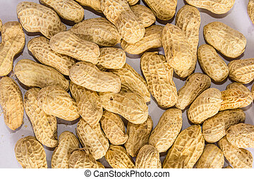 Groundnuts - Close up groundnuts on white background
