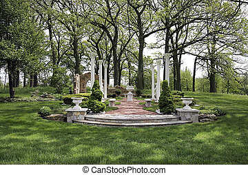 Grounds of luxury home with pillars and stone steps