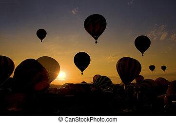 Group balloon launch at a balloon festival.