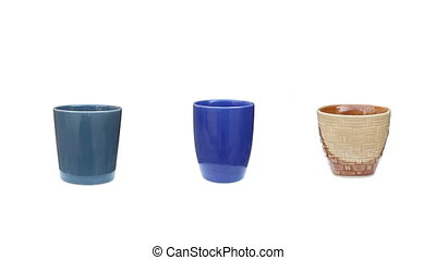 group ceramics cup rotation on isolated white