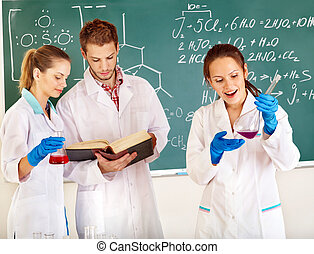 Group chemistry student with flask. - Group chemistry...
