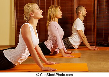 Group doing yoga exercise