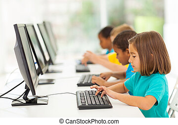 elementary school students in computer class - group...