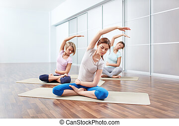 group exercise young girl in lotus position