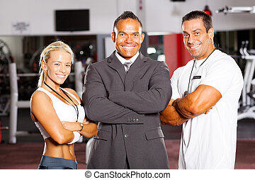 group gym manager and trainers - happy group gym manager and...