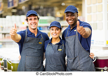 hardware store workers giving thumbs up - group hardware...