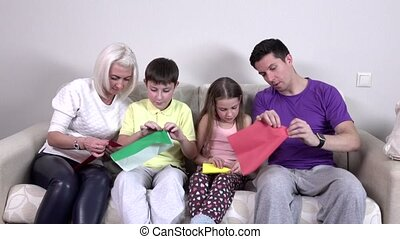 Group kids make origami airplane, weekend with family, very...