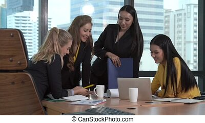 Group meeting of professional businesswomen thinking with new project planning. Teamwork and collaboration concept.