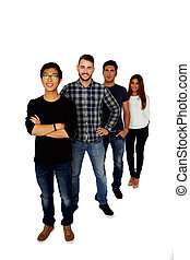 Group of a happy students standing in a row over white background