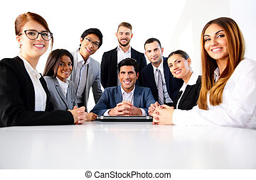 Group of a smiling colleagues in office