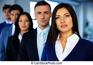 Group of a young businesspeople looking at camera