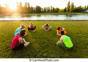 Group of active women training in the circle