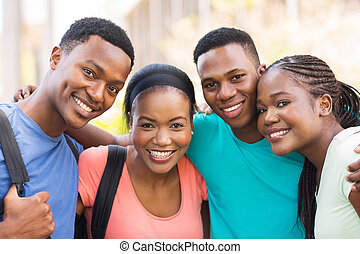 group of african college friends hugging