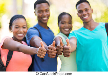 group of african college friends thumbs up