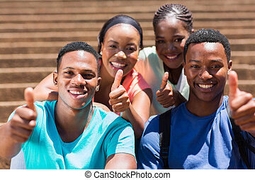 group of african friends giving thumbs up