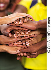 group of african students hands together closeup