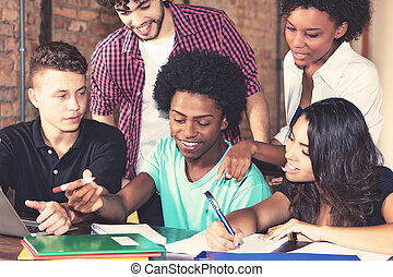 Group of american students learning at university