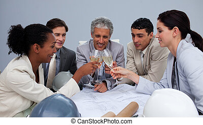 Group of architects celebrating success with champagne