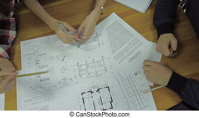 Group of Architects Planning on a New Project with their Blueprint