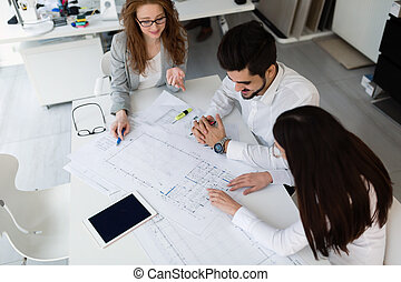 Group of architects working together on project