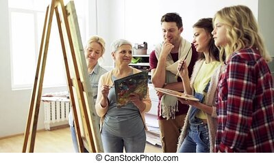group of artists discussing painting at art school